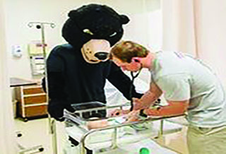 LRU Nursing Student with Baby and Bear Mascot